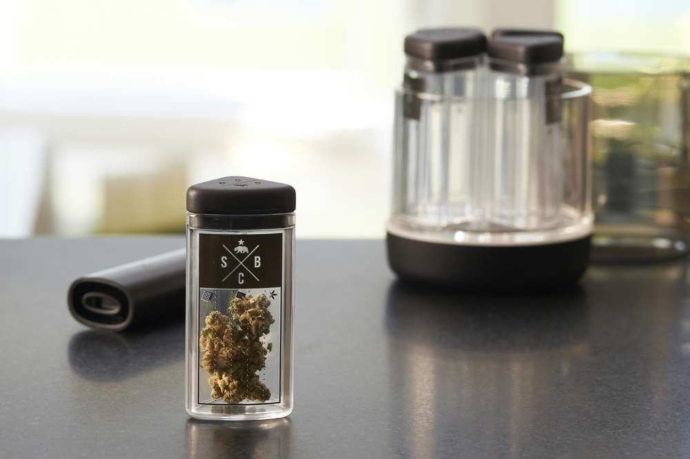 Complete system.  A set of inner bottles separate strains of marijuana. Each bottle cap has slots to allow airflow and humidity control for each strain while the system is sealed. Removable, static-cling labels help keep things organized.