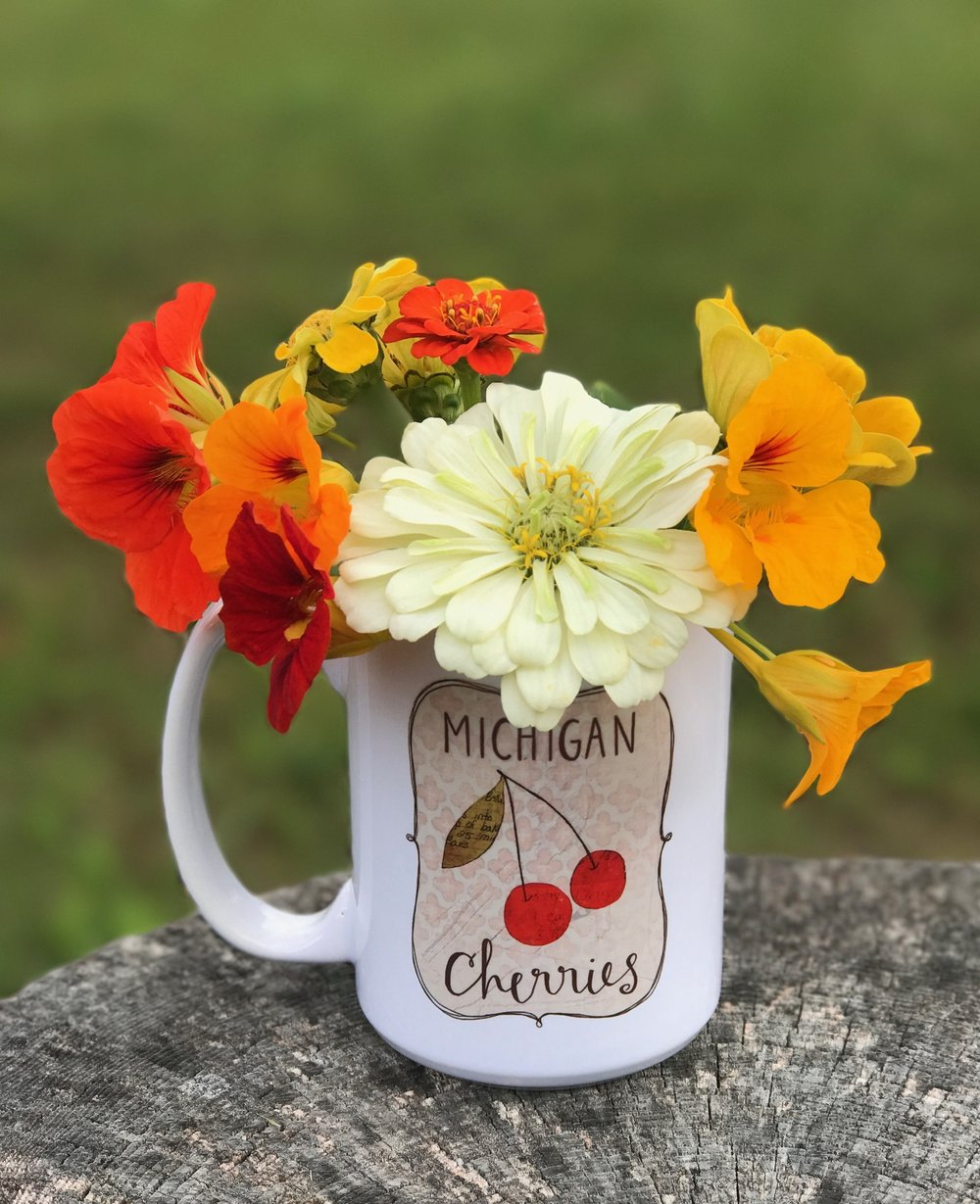 Stop into Two Fish Gallery to snag your own Michigan Cherries mug & to see our whole collection of Polka Dot Mitten creations