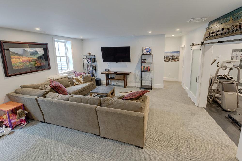 31.1-Basement Living Area.jpg