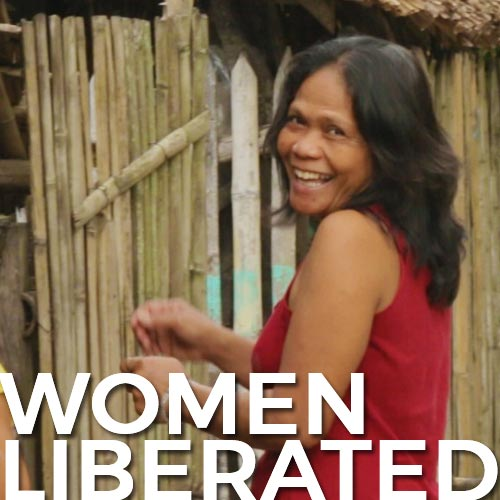 "A joyful woman looking over her shoulder with the words ""women liberated"" written on the bottom"