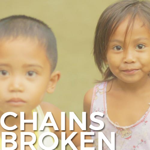 "Two kids from the rural Philippines looking at you with the words ""chains broken"" written on the bottom"