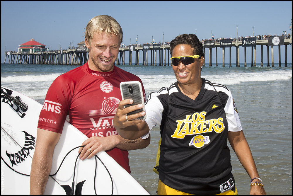 Kolohe Andino stops for a fan photo at the US Open of Surfing //  Huntington Beach