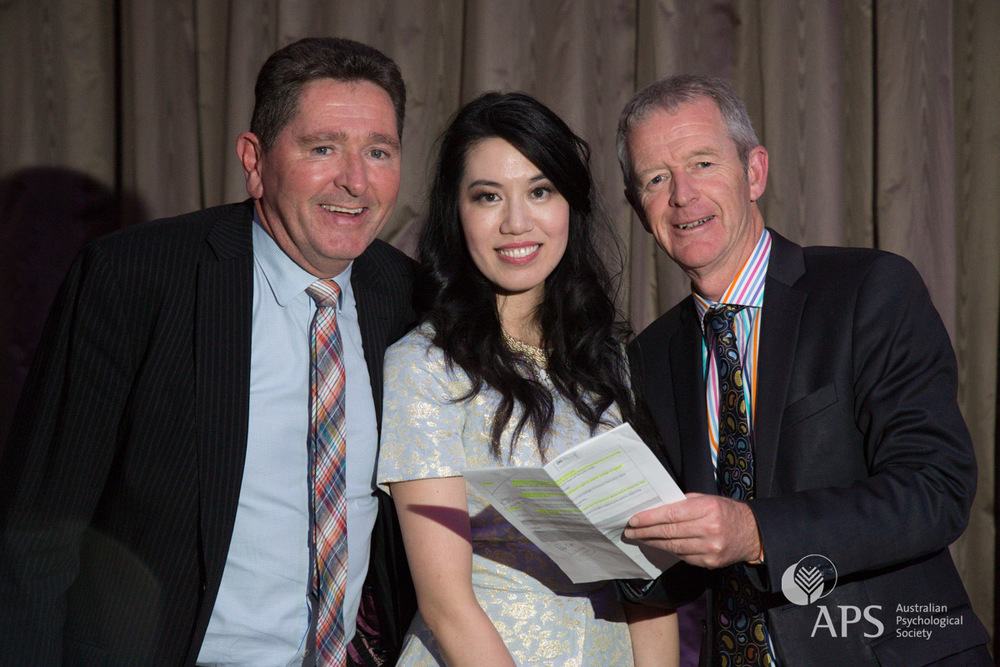 Pat Freeland-Small and Angela Tang of the Australian Psychological Society with Workplace Excellence Awards 2015 MC Ian Cover