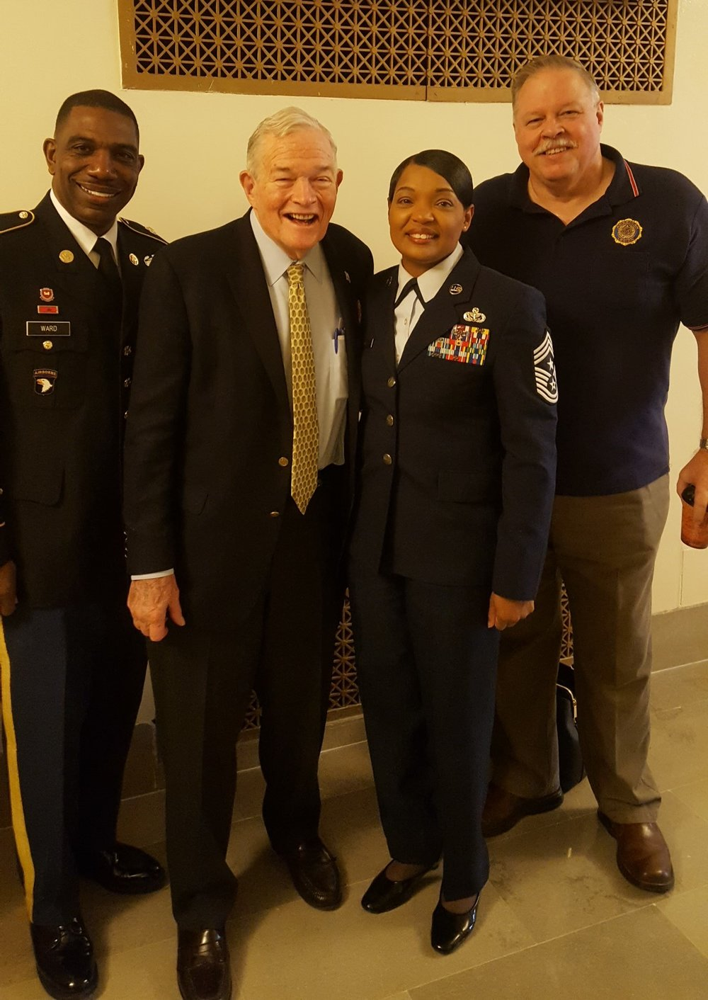 Senator Kit Bond posing with our military heroes