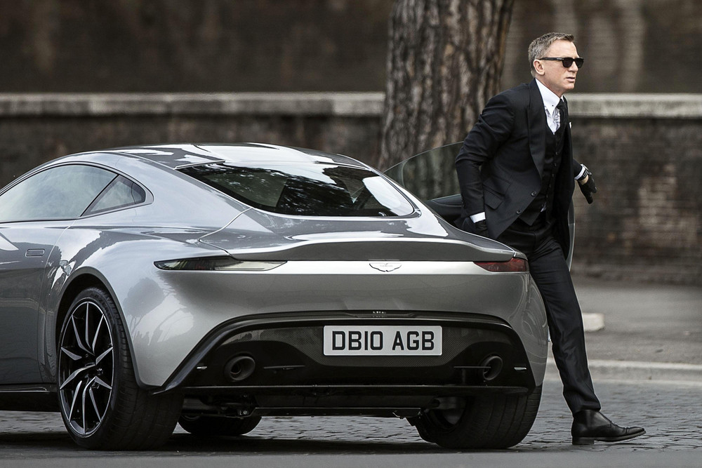 Bond walking away from his all new Aston Martin DB10