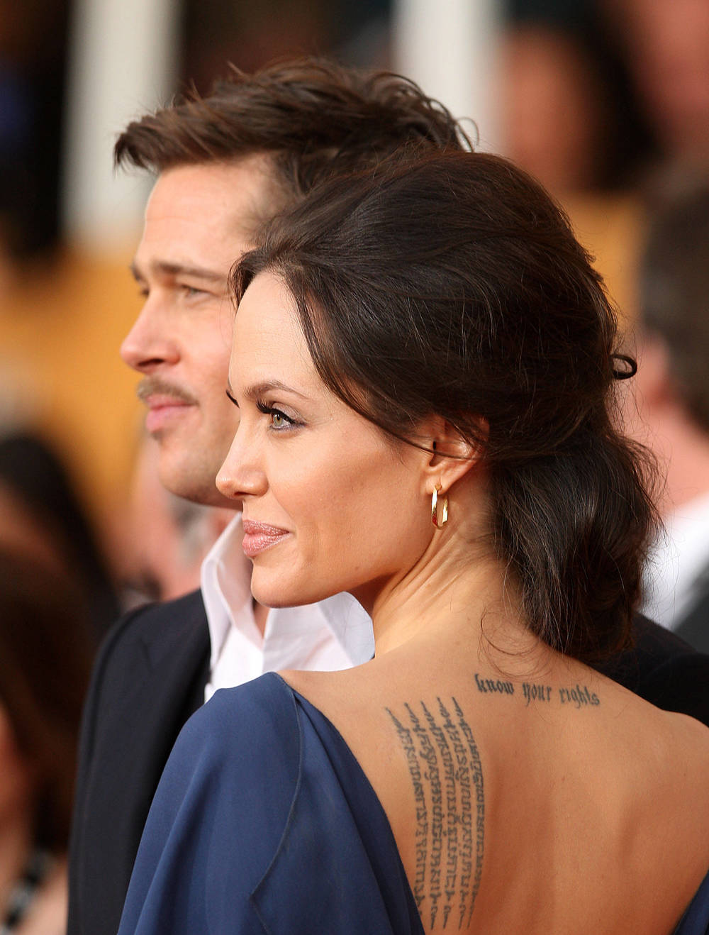 """I dropped my pants in a tattoo parlor in Amsterdam. I woke up in a waterbed with this funky-looking dragon with a blue tongue on my hip. I realised I made a mistake; so a few months later I got a cross to cover it. When my pants hang low, it looks like I'm wearing a dagger!"" — Angelina Jolie"