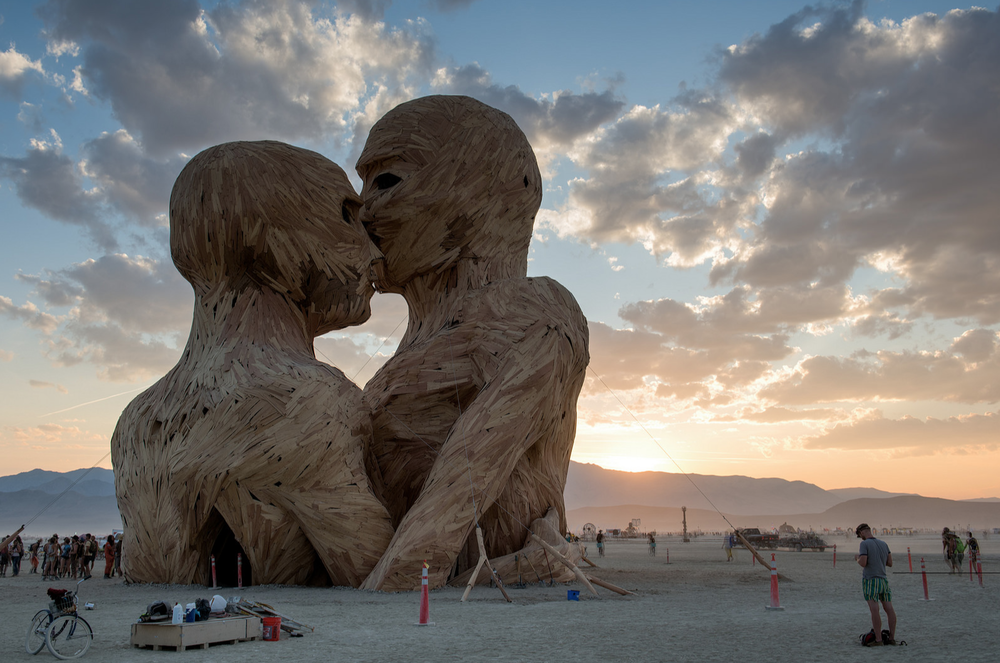 """Embrace is a 7 story tall wooden cathedral-like sculpture of two human figures in an embrace. It is a spiritual centre dedicated to the moment and our relationships with our loved ones"" — Lukasz Szczepanski."