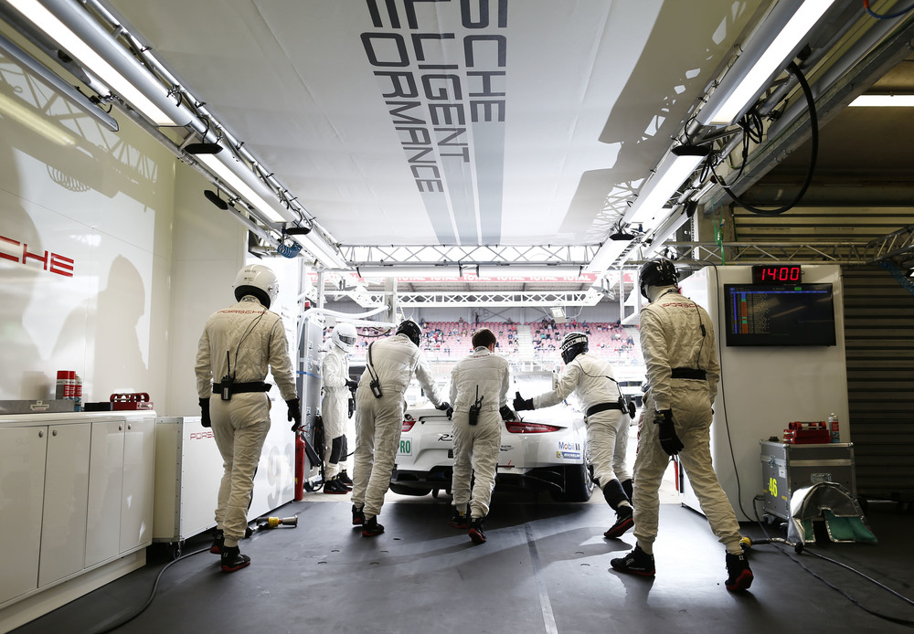 The Porsche pit crew may be away from the spotlight, but they strive towards a common goal.
