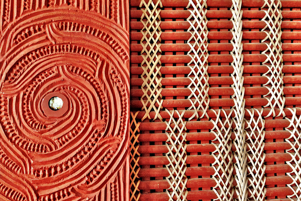 Detail of an ornate carving (whakairo) and woven wall panel (tukutuku) at Te Hahi O Te Whakapono (The Church of the Faith), Rotorua. Commonly known as St. Faith's, the first Christian church service in Rotorua was held here on October 30, 1831.