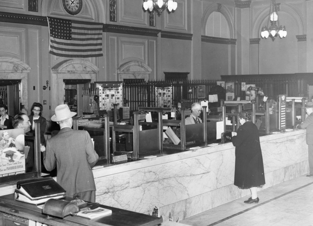Circa 1920. The imposing banking hall which overpowers the customers has remained remarkably similar over the century.