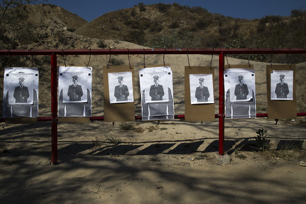 "Jews Can Shoot  teaches California residents how to shoot firearms to protect themselves. Pictured here is a line of Hitler ""posters"" about to be shot at."