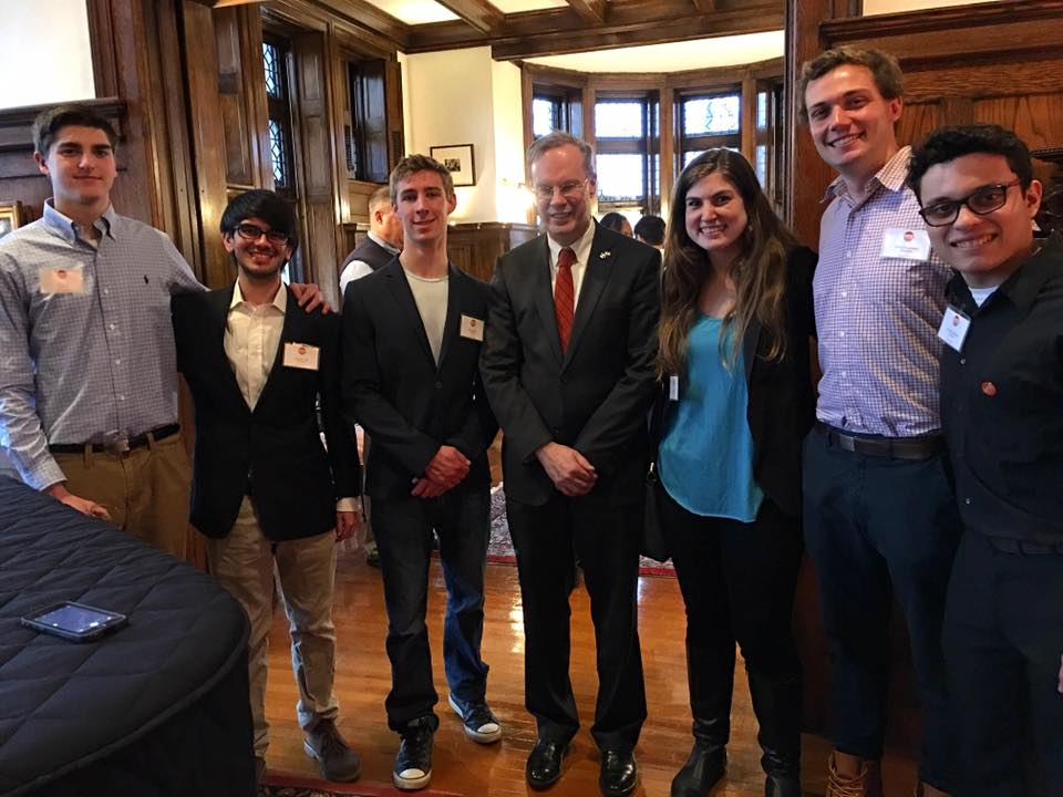 Eric Cola, Gabriel Ortiz, Will Carrara, Chancellor Kent Syverud, Shira Stoll, Elliot Greenwald, and Christian Merced Cruz at the Chancellors house in Syracuse, NY.