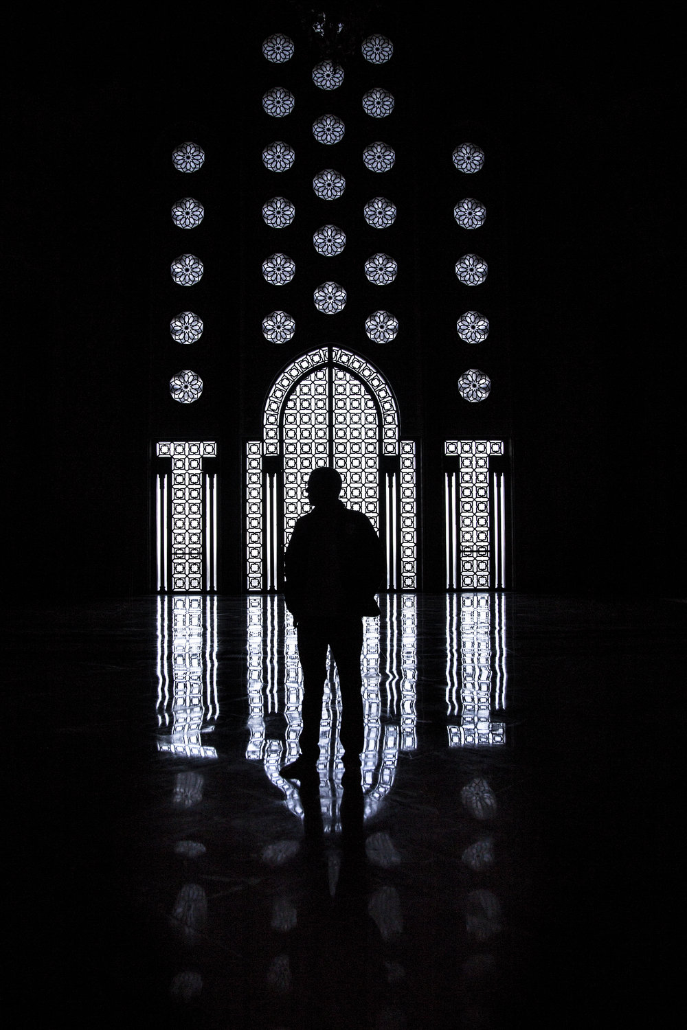 A tourist gazes at the architecture of the Hassan II Mosque in Casablanca, Morocco on December 20, 2017.