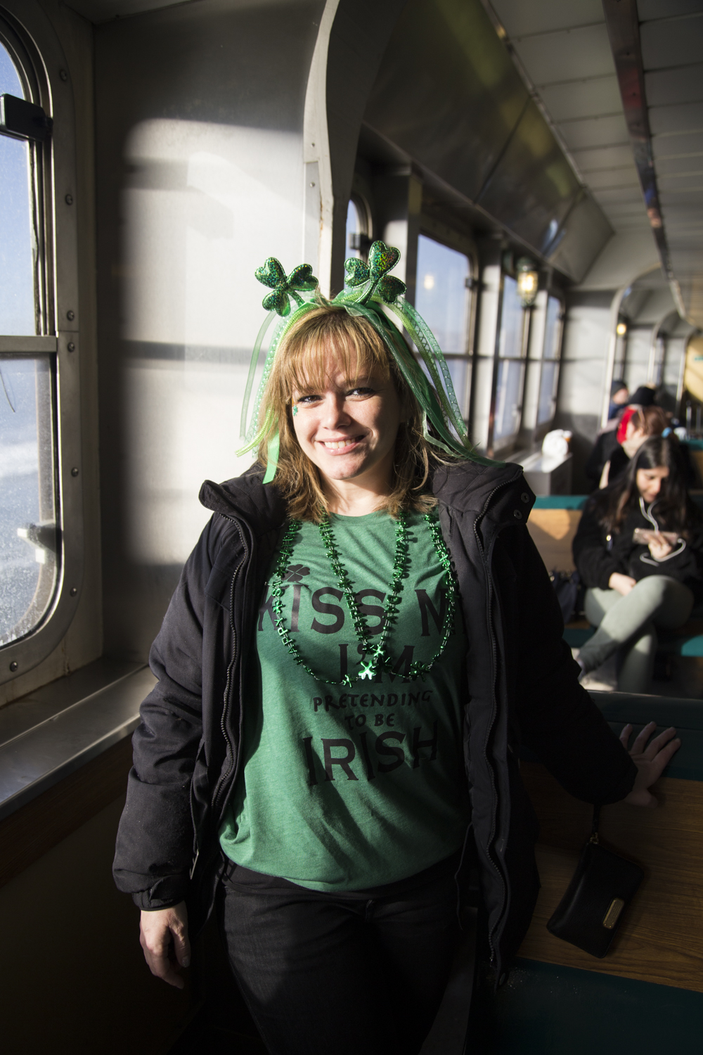 Luz Morales from Manhattan rides the Staten Island Ferry to Manhattan for the St. Patrick's Day Parade. (Staten Island Advance/Shira Stoll)