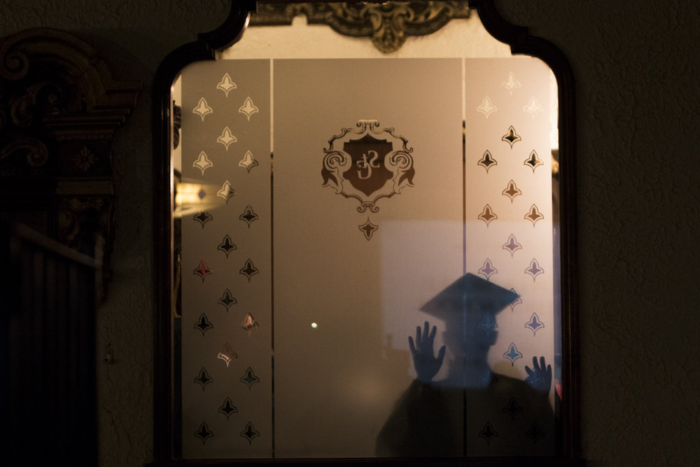 A graduate looks into the St. George Theatre where he is about to walk on stage before the Ralph R. McKee Career and Technical High School graduation on June 25, 2018.