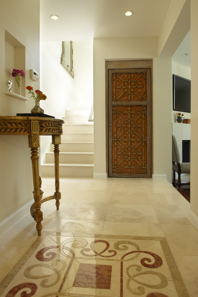 alabaster tile with inset stone medallion with antique hand made door
