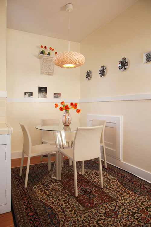 Modern Italian chairs and Lucite table in this inviting breakfast nook