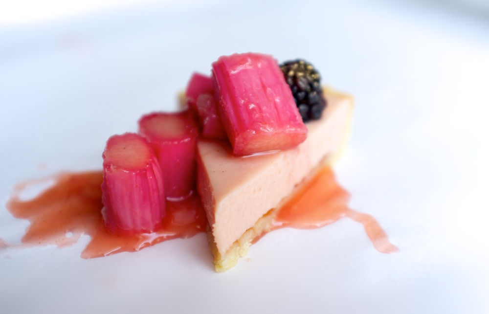 Rhubarb white chocolate tart served with rhubarb, orange, ginger and honey compote.