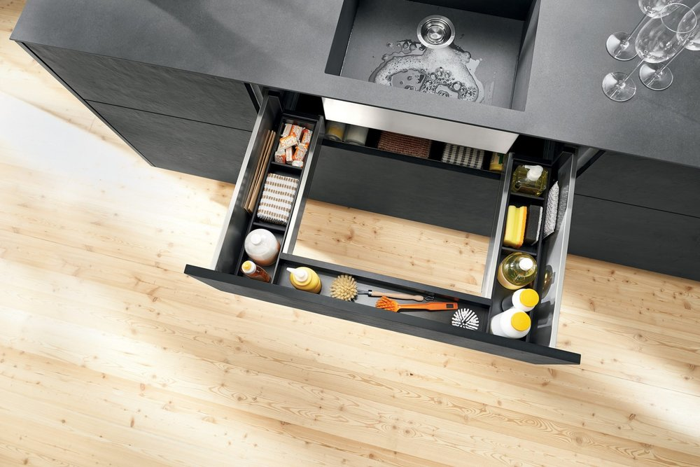 Make use of otherwise dead space at your sink area (Blum hardware)