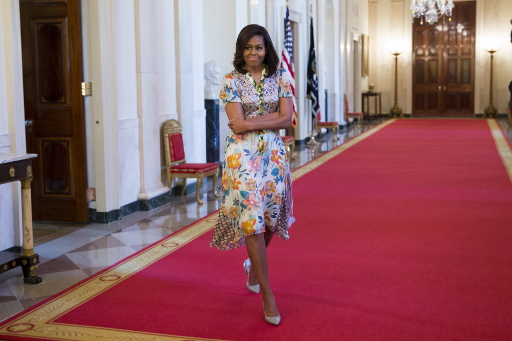 FLOTUS floted on the White House red carpet in a mixed print floral with graphic side detail dress by Duro Olowu.