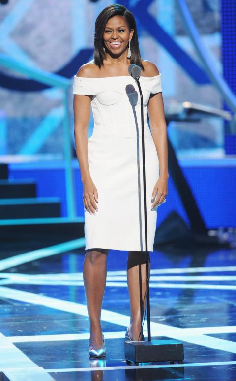 "During BET'S ""BLACK GIRLS ROCK"" wowing the crowd in a off-the-shoulder white ZAC POSEN dress."