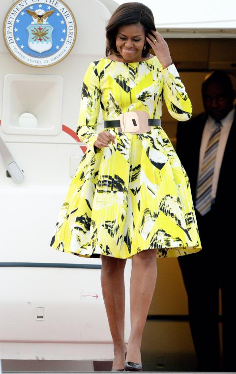 For her first visit to Japan, the First Lady arrived looking radiant in a lime green graphic-print dress by Kenzo.