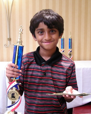 Anish Bandharam (1205) wins clear 1st Place in the U1200 Scholastic section with a perfect score of 5-0 as well! Great job Anish!