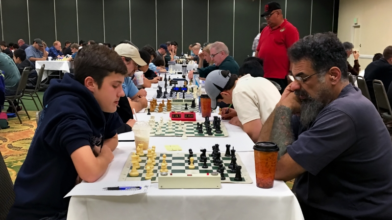 Round 2, Class A, Ryan Hamley (1887) (L) vs Dimitri Kosteris (1723) (R) with Ryan Hamley going on to win the matchup.