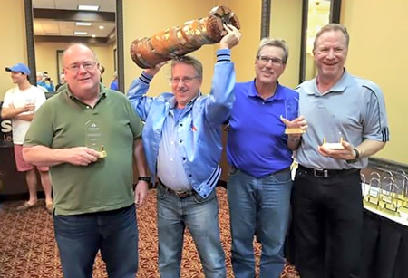 Team Chakis-mate are the champions at the 2016 US Amateur Team South Tournament in Tampa, FL. From L-R, Bob Persante (2200), Peter Dyson (2144) with the Rotating Rook trophy, Larry Storch (2204) and John Nardandrea (2234)