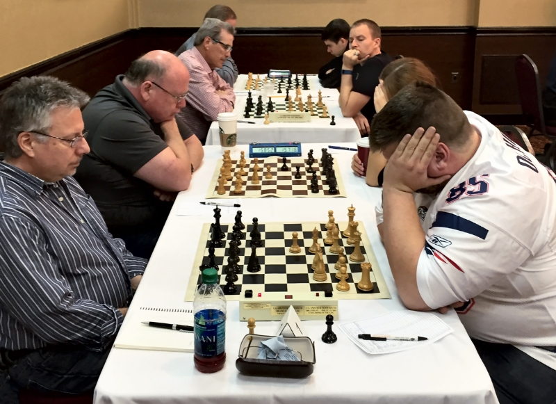 Round 3, Peter Dyson (2144) (L) of team Chakis-mate vs Steven Abrahams (1972) (R) of team Victorious Secret at the US Amateur Team South tournament, held in Tampa, FL. last weekend.
