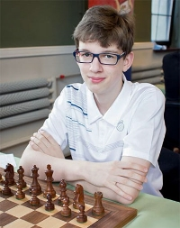 GM Janek-Krzysztof Duda (FIDE 2660), World Champion Under Age 10 & European Rapid Champion at age 16.