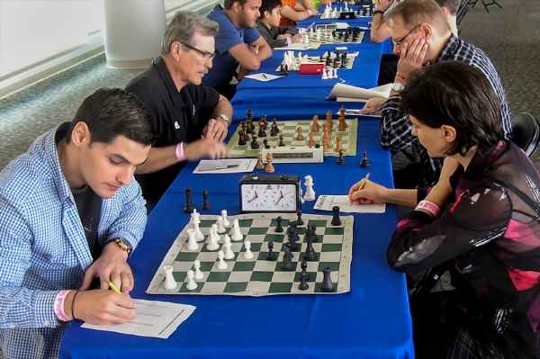 Board One, Round 3, Jose Manuel Calvo Quinteiro (FIDE 2307) (L) vs WIM Evgenia Hansen (2206) (R) and Board Two with Larry Storch (2204) (L) vs GM Lars Bo Hansen (2623) (R) at the CFCC/Magic Chess Knight USCF Quick Chess tournament held in the DEX Imaging Room at the Amway Center prior to the Magic vs Indiana Pacers basketball game that night.