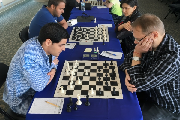 Board One, Round 4, Jose Manuel Calvo Quinteiro (FIDE 2307/USCF unrated) (L) vs GM Lars Bo Hansen (2623) (R) at the CFCC/Magic Chess Knight USCF Quick Chess tournament.
