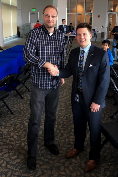 GM Lars Bo Hansen (L) being congratulated by the Orlando Magic's Zack Cervone at the conclusion of the first-ever USCF Chess Tournament & Magic Basketball Game Night event held last Sunday at the Amway Center!