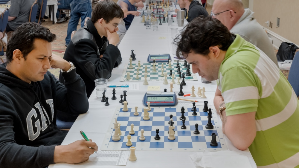 Premier Section Board 1, Round 5: IM Rafael Prasca Sosa (2446) (L) vs GM Sandro Pozo Vera (2561) (R) in CFCC's 2016 Sunshine Open held at the Wyndham Orlando Resort on I-Drive.
