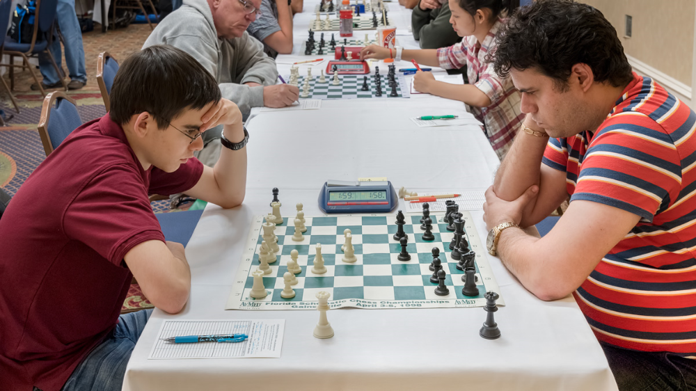 Premier Section- Board 1, Round 3, John Ludwig (2463) (L) vs GM Sandro Pozo Vera (2561) (R) in a game that ended in a draw, helping John win the CFCC 2016 Sunshine Open on tie-break points for 1st place overall. Congratulations John!