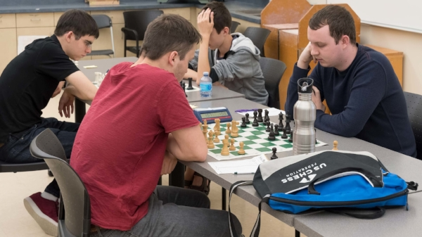 FM Dalton Perrine (R) Lead Instructor for  Chess.com University  online chess training.