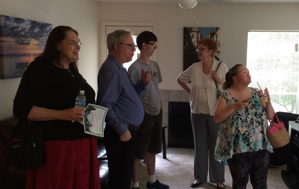 parents at open house DISCUSSING Apartment living
