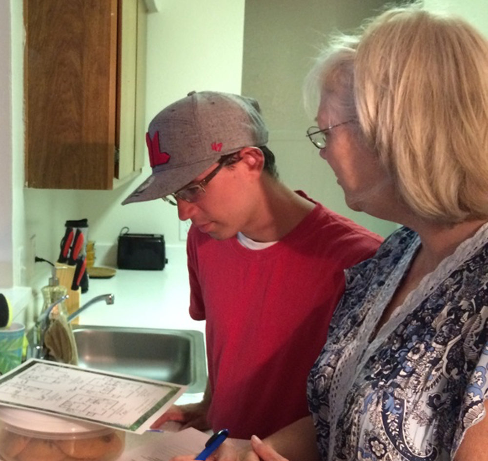 Son and Mom discussing apartment floor plans