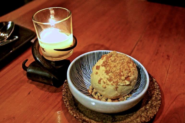 Frozen single scoop of homemade peanut butter ice cream