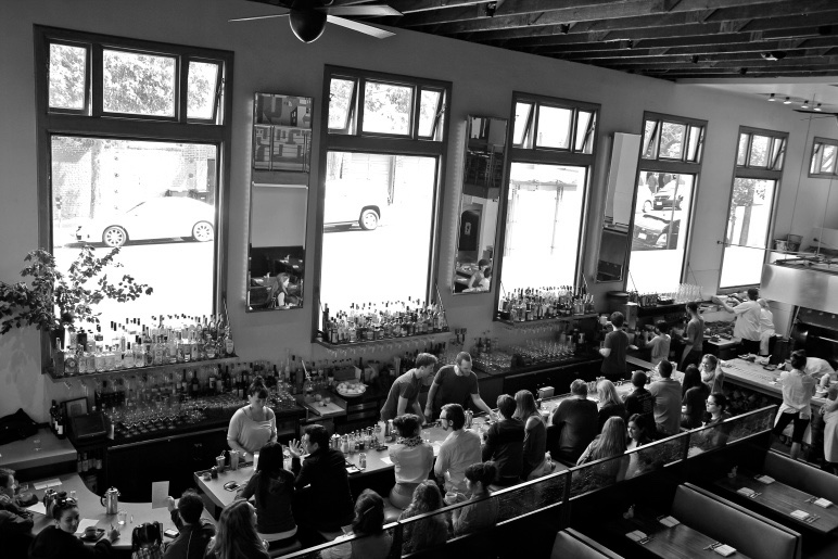 View of the bar and open-kitchen from the second level.