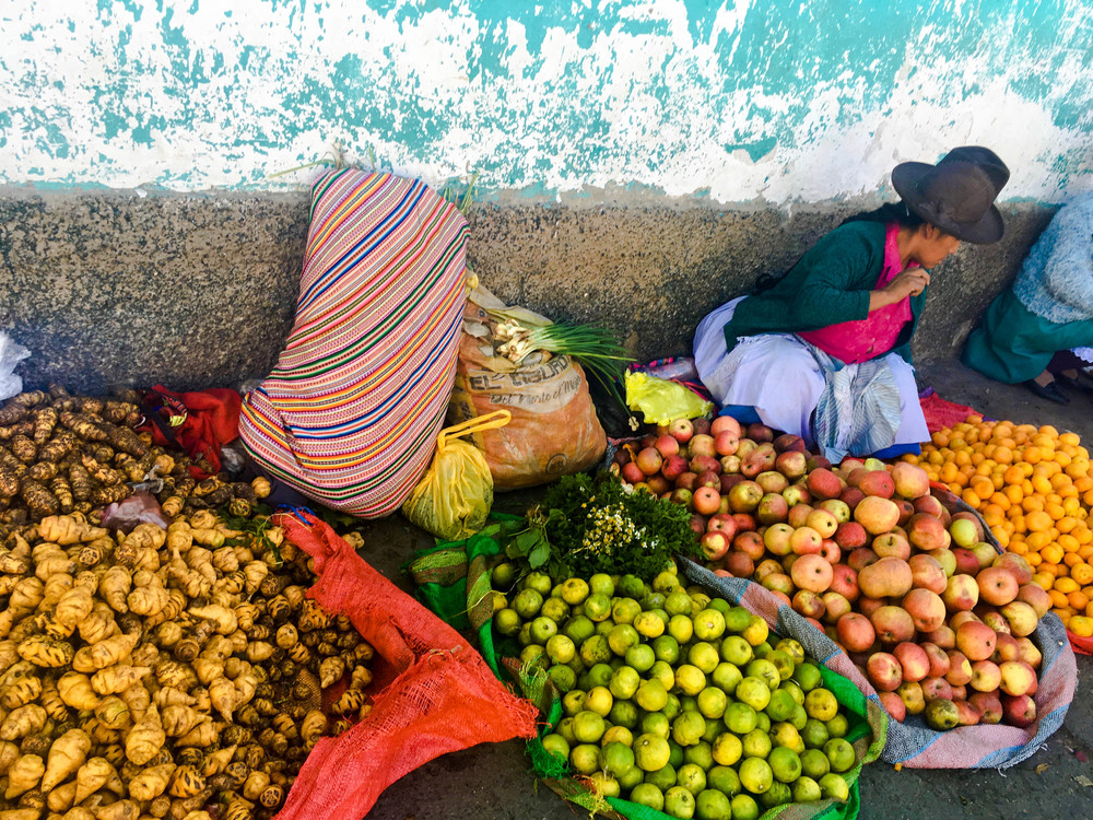 Fruits and potatoes. Many of the women sell their produce on the street instead of in formal stalls. Many men have left these rural villages in search of better economic opportunities, leaving the women to cultivate the land.
