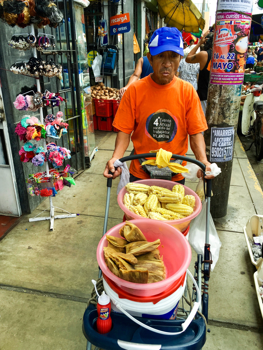 Corn and tamales (made of corn) in a stroller.