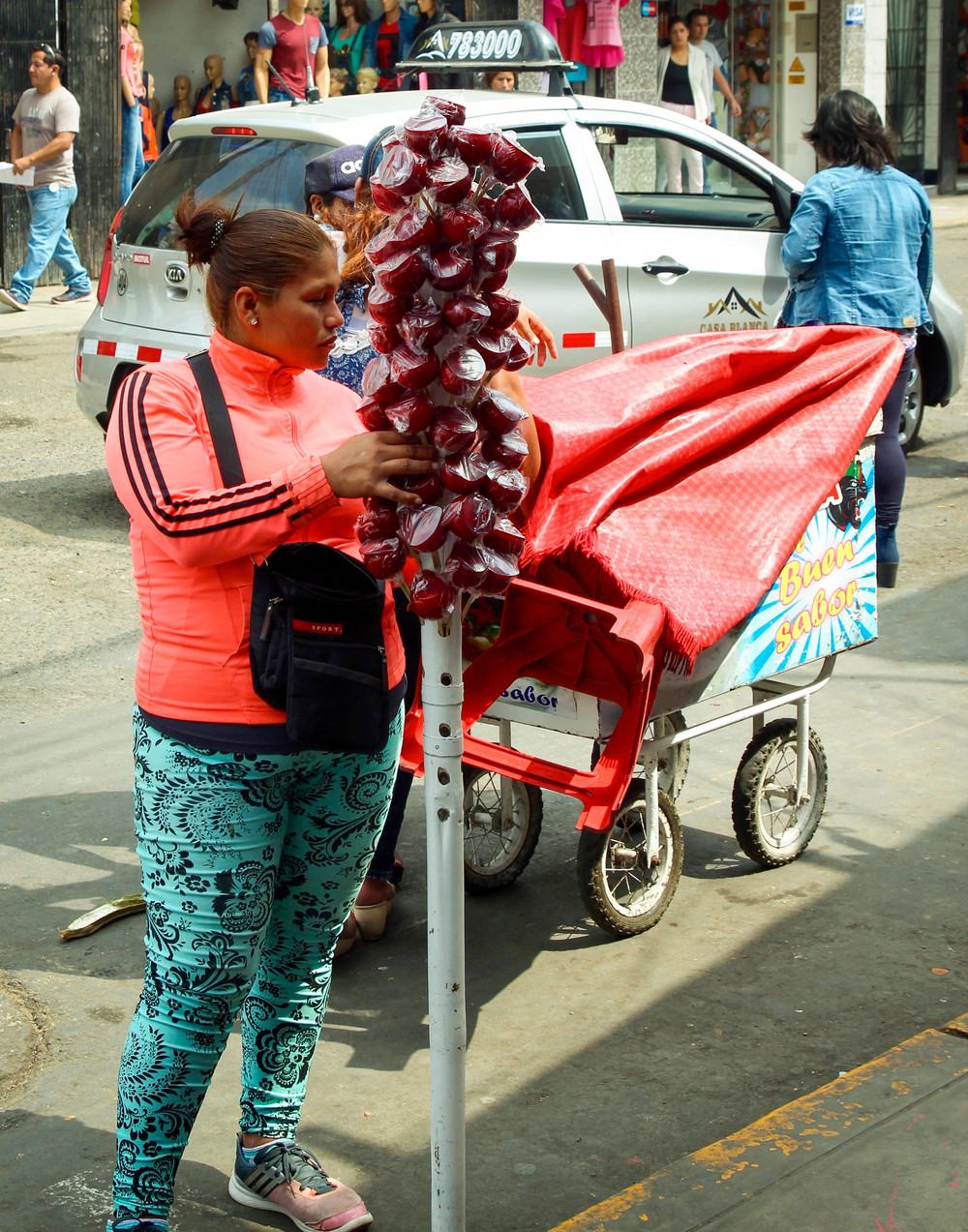 Sugar, sugar and more sugar. Amongst the scale vendors you will find many food vendors, most of whom sell sugary snacks (such as these red, candy apples) or mazamorra morada (Peruvian purple corn pudding).