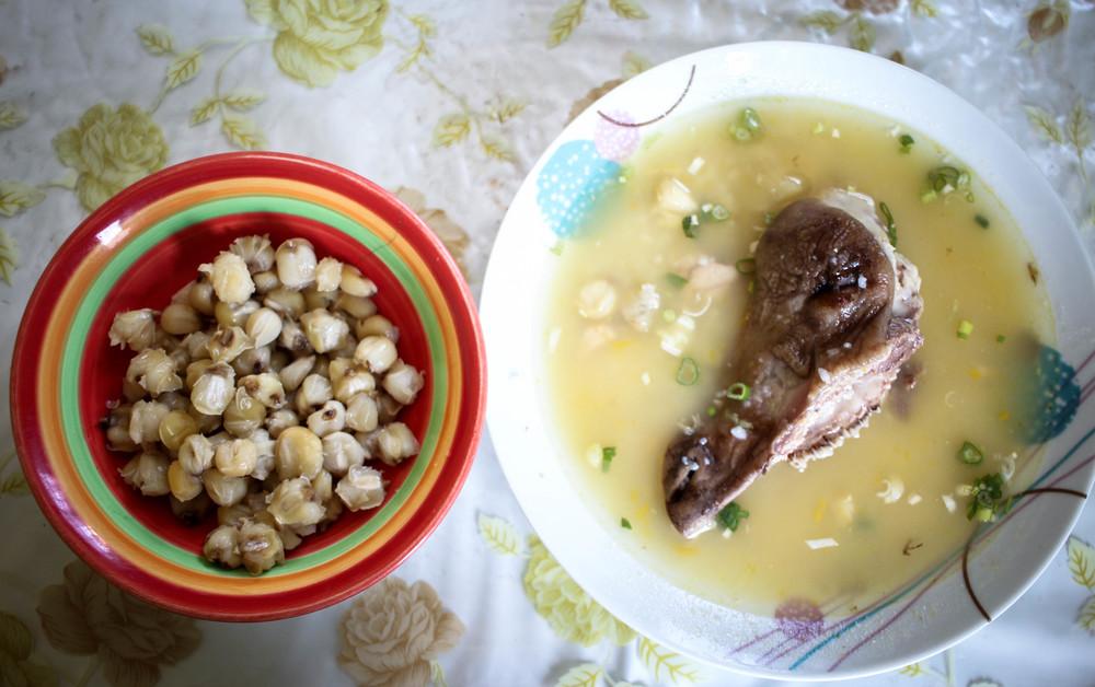 Mote (corn kernals) with caldo de cabeza (goat head soup).