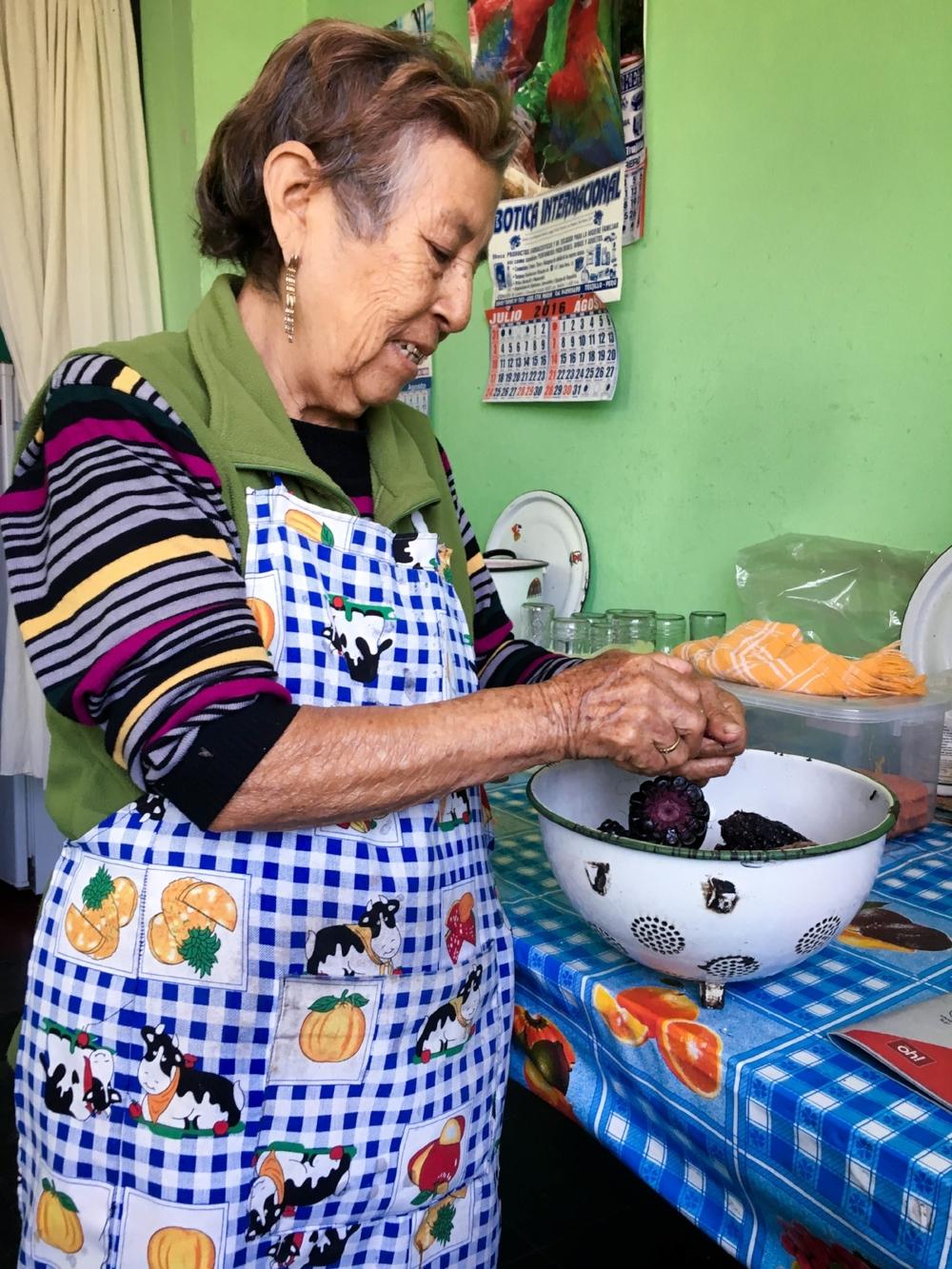 Esperanza preparing the purple maize for the chicha morada beverage.