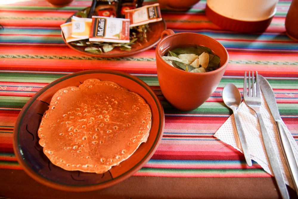 Pancake breakfast with coca leaf tea on Lake Titikaka. There were no accompaniments to the cooked dough.