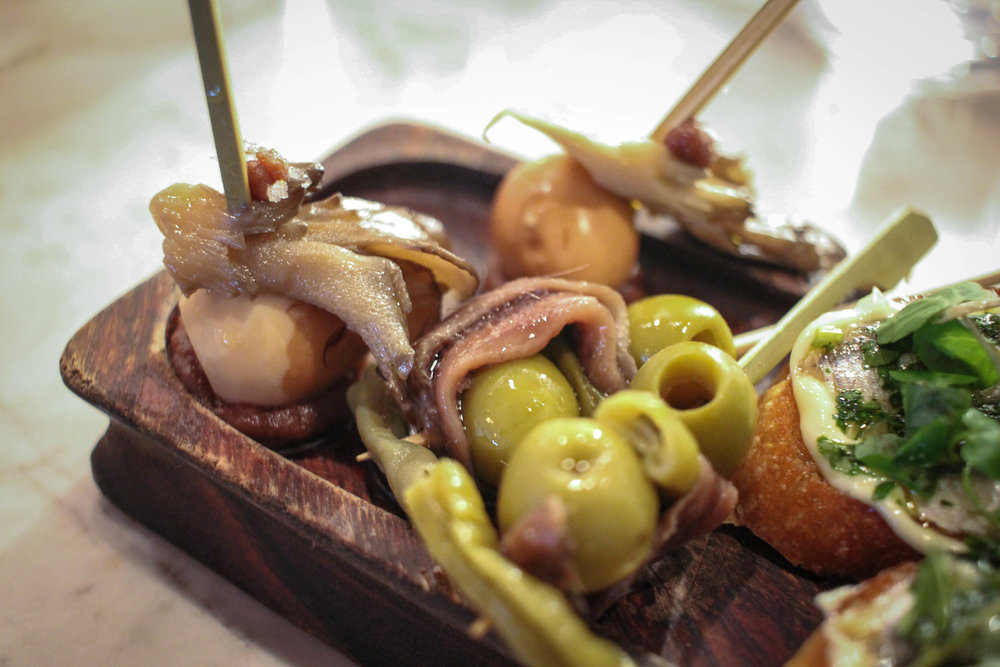 1. Smoked quail egg & mushroom 2. Pintxo Gilda (olives, anchovies, pickled green beans)