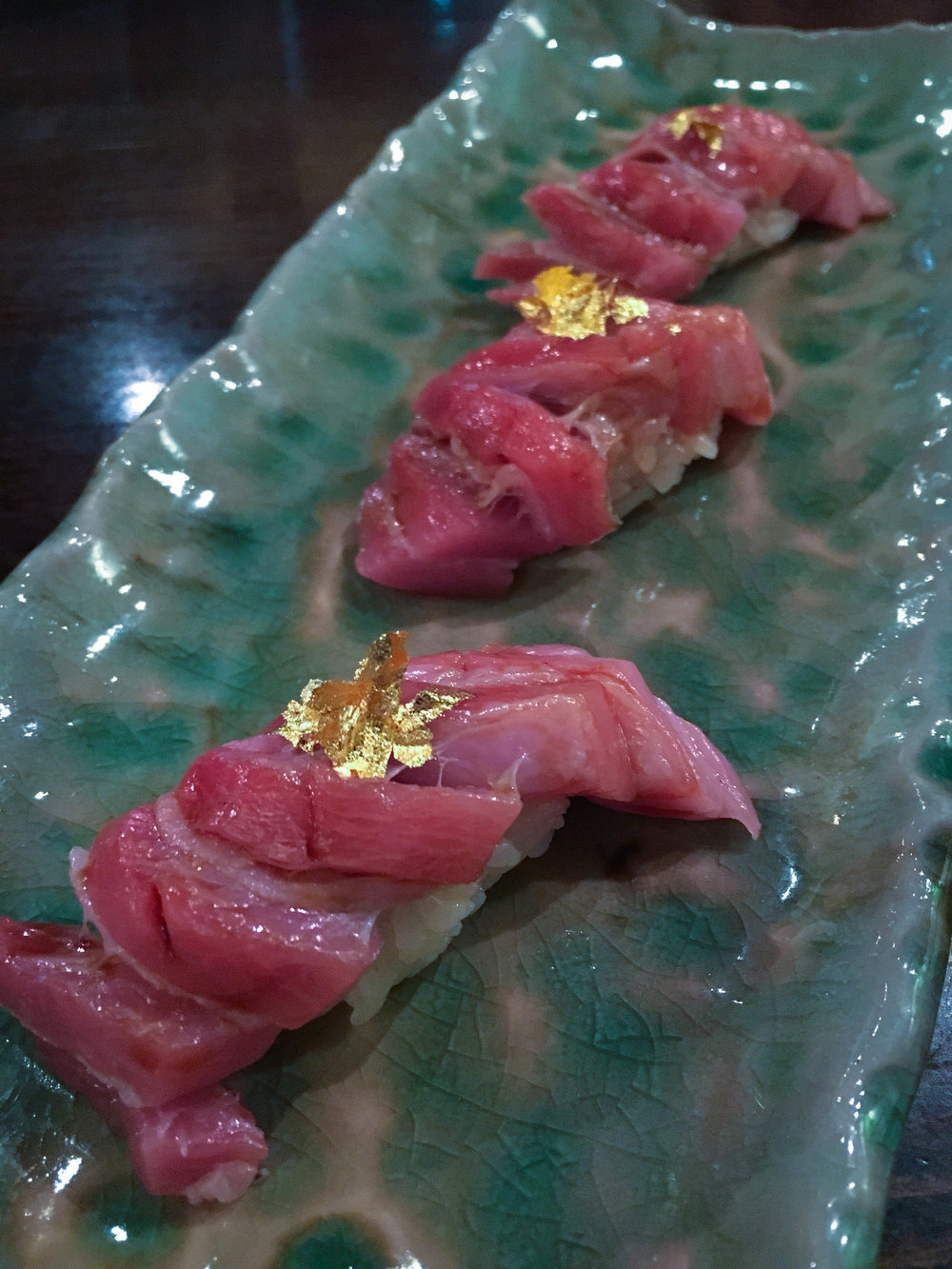 Edible gold on top of medium fatty tuna