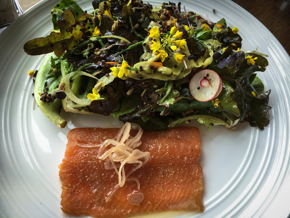 Smoked Lomi Trout with whole baby greens salad, toasted sesame vinaigrette, radishes, grilled taro sweet bread